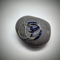 168. Prsten modrého třpytu
